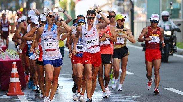 Athletics , Men's 50km WalkTokyo 2020 Olympics - Athletics - Men's 50km Walk - Sapporo Odori Park, Sapporo, Japan - August 6, 2021. Matej Toth of Slovakia and Dawid Tomala of Poland in action REUTERS/Kim Hong-Ji