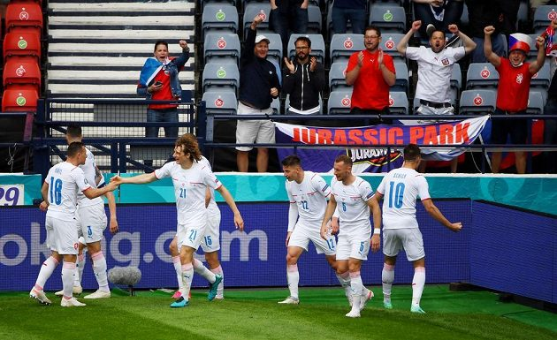 Imagination.  Czech striker Patrik Schick celebrates with his teammate a goal that scored the EURO in the Scottish net.