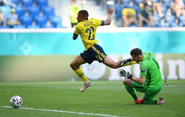 Slovak goalkeeper Martin Dúbravka fouls the Swede Robian Quaison.