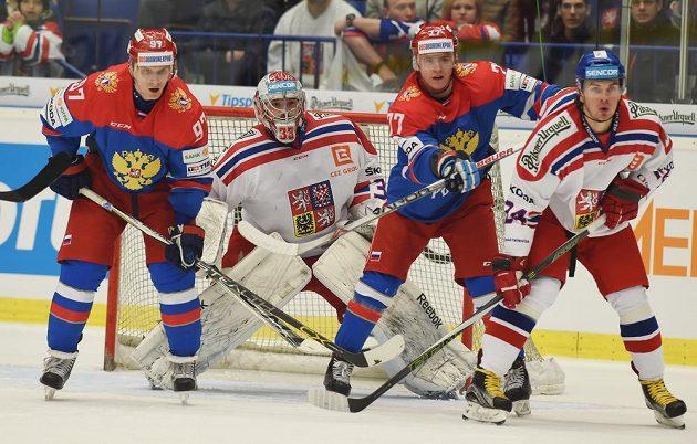 Zleva Maxim Karpov z Ruska, Dominik Furch z Česka, Sergej Šumakov z Ruska a Petr Zámorský z Česka při utkání Euro Hockey Tour v Ostravě.