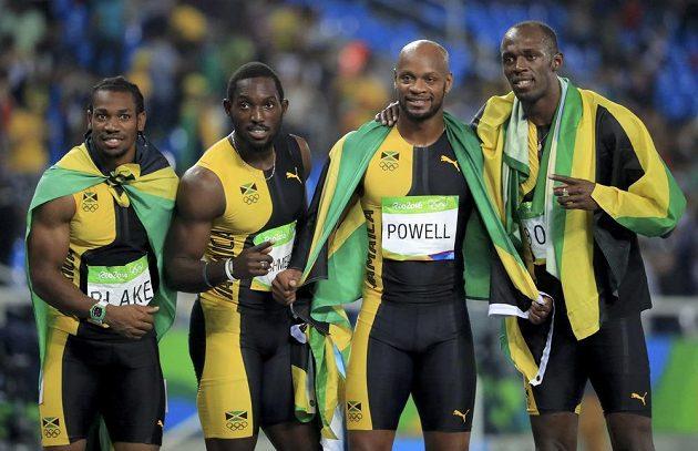Zlatí jamajští sprinteři ve štafetě na 4x100 metrů: (Zleva) Yohan Blake, Nickel Ashmeade, Asafa Powell a Usain Bolt.