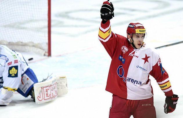 Slávistický útočník Jiří Doležal slaví gól v síti Komety Brno v dohrávce 25. kola Tipsport extraligy.