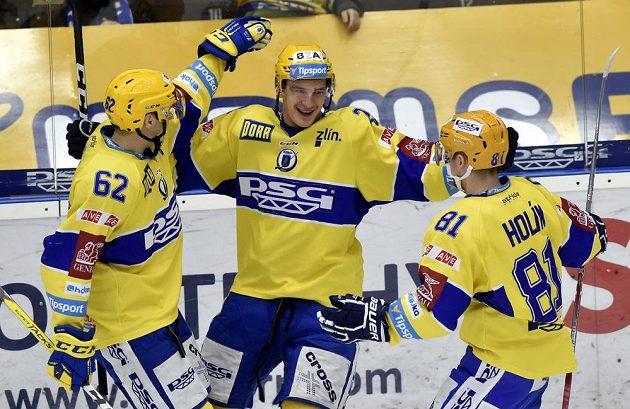 Zleva Robert Říčka, David Šťastný a Petr Holík ze Zlína se radují z gólu.