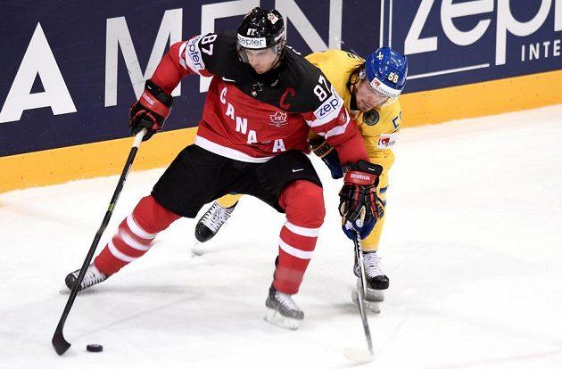 Kanadský útočník Sidney Crosby (vlevo) bojuje s Antonem Landerem ze Švédska.