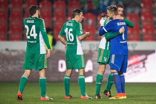 Fotbalisté Bohemians (zleva) Milan Havel, Martin Dostál, Michal Šmíd a Viktor Budinský po utkání se Slavií.