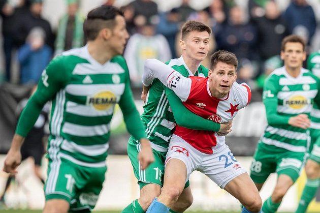 Daniel Krch z Bohemians a Lukáš Masopust ze Slavie Praha během utkání 23. ligového kola.