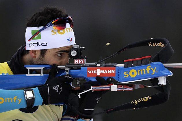 Francouzský biatlonista Martin Fourcade při střelbě ve sprintu v Ruhpoldingu.