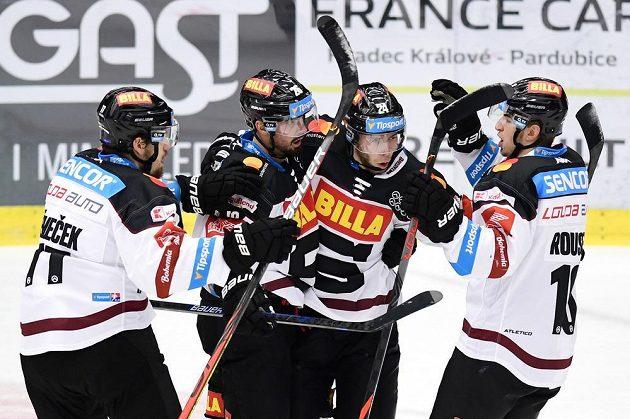 Hokejisté Sparty (vlevo) David Nemişik, Michel Chebek, Match Sokic a Lucas Rusk slaví gól.