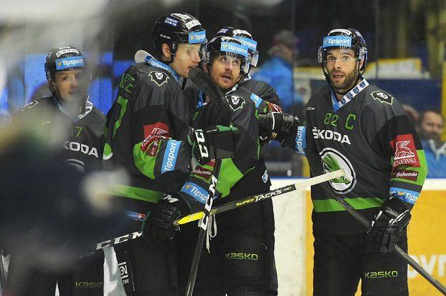 Hokejisté Mladé Boleslavi (zleva) David Bernad, David Němeček, Lukáš Pabiška a Michal Vondrka se radují z gólu v Plzni..
