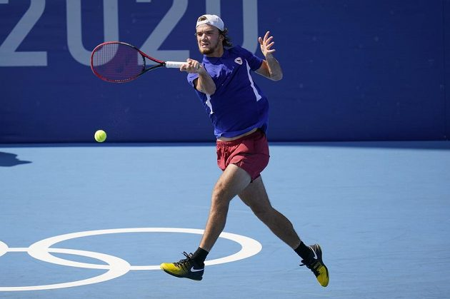 Tomas Machac, of the Czech Republic, returns to Diego Schwartzman, of Argentina, during second round of the men's tennis competition at the 2020 Summer Olympics, Tuesday, July 27, 2021, in Tokyo, Japan. (AP Photo/Patrick Semansky)