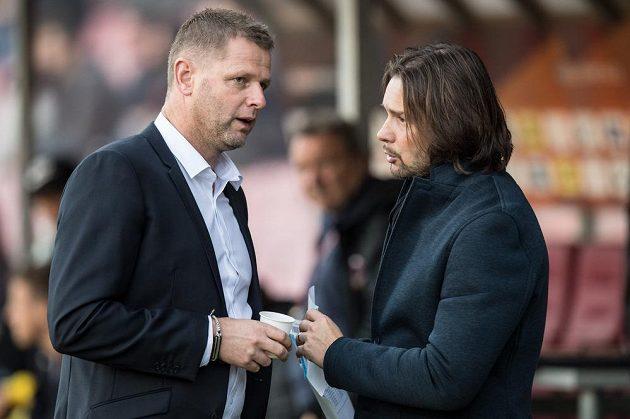 Trenér Baníku Ostrava Radim Kučera (vlevo) a člen dozorčí rady klubu Marek Jankulovski před pohráovým utkáním na Spartě.
