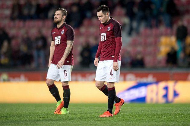 Fotbalisté Sparty Praha Vjačeslav Karavajev a Lukáš Vácha po utkání se Zlínem.