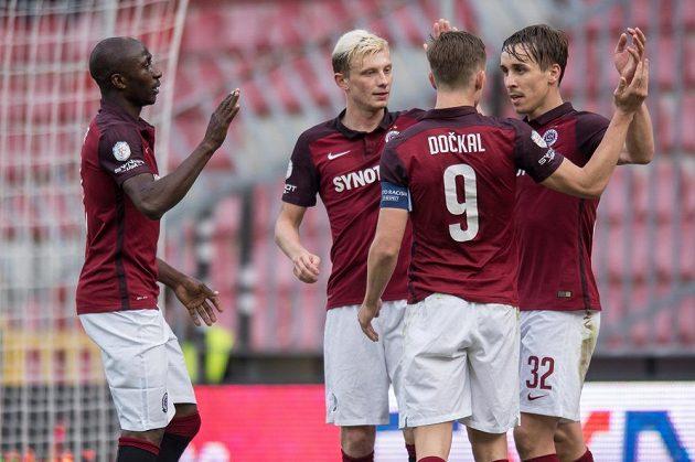 Fotbalisté Sparty Praha (zleva) Kehinde Fatai, Ladislav Krejčí, Bořek Dočkal a Josef Šural slaví gól.