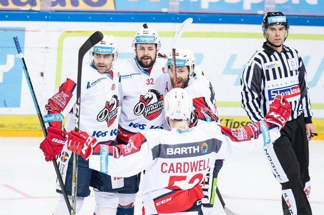 Hokejisté Pardubic (zleva) Tomáš Rolinek, Rostislav Marosz, Marek Hovorka a Jacob Cardwell oslavují gól na 1:0 během utkání na Spartě.