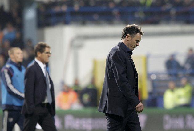 Kouč Černé Hory Branko Brnovič (vpravo) a trenér Rusů Fabio Capello.