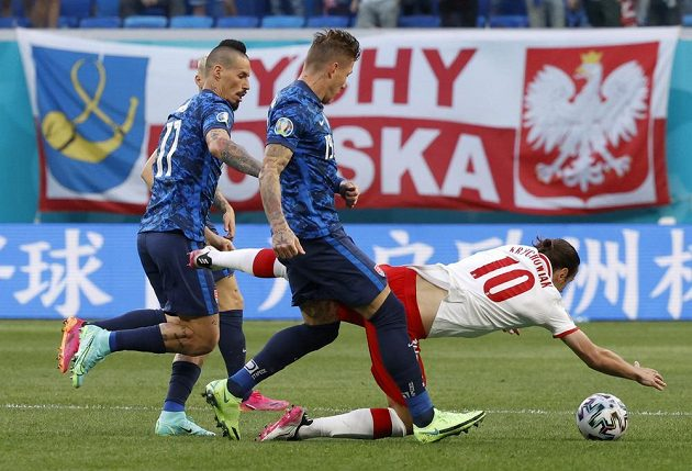 Polish footballer Grzegorz Krychowiak falls to the ground after a duel with Slovak Juraj Kucka, Slovak Marek Hamšík also took part in the duel for the ball in the EURO match.