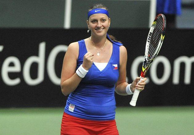 Petra Kvitová se raduje po výhře nad Jarmilou Gajdošovou z Austrálie.