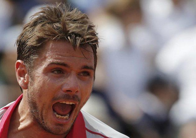 Reakce Stana Wawrinky po vítězné výměně s Novakem Djokovičem ve finále French Open.