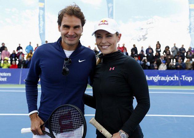 Švýcarský tenista Roger Federer a americká lyžařka Lindsey Vonnová před začátkem exhibice.