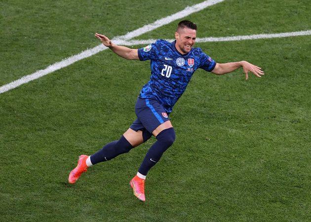 Slovak football representative Robert Mak celebrates a goal in the Polish net during the EURO match.