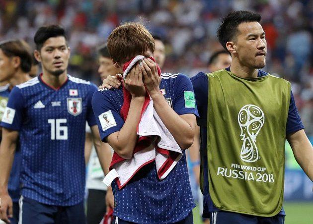 Smutek japonských fotbalistů po vyřazení v osmifinále MS.
