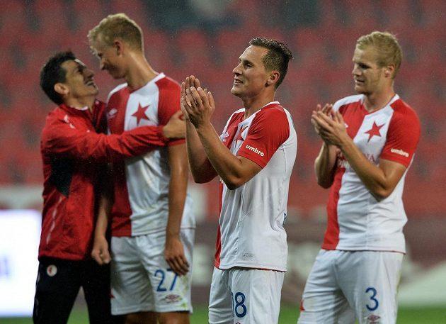 Hráči Slavie se radují z vítězství nad Libercem. Zprava Jan Mikula, Jan Bořil a Antonín Barák.