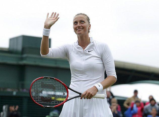 Petra Kvitová se raduje z vítězství nad Rumunkou Soranou Cirsteaovou.