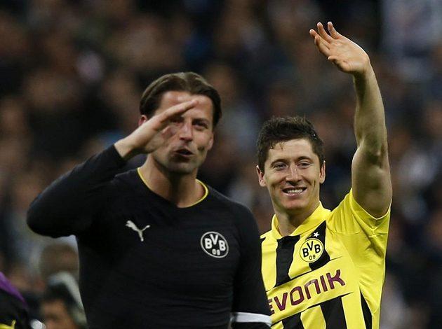Robert Lewandowski (vpravo) sice v Madridu neskóroval, ale jeho čtyři góly z Dortmundu nakonec stačily.
