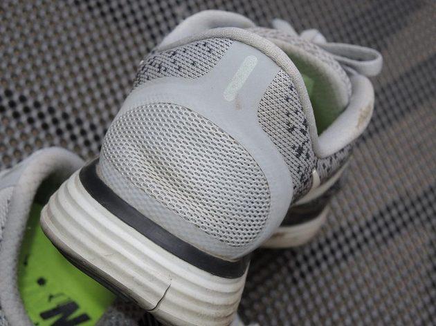 Boty Nike Free RN Distance - pata nese malý reflexní prvek.