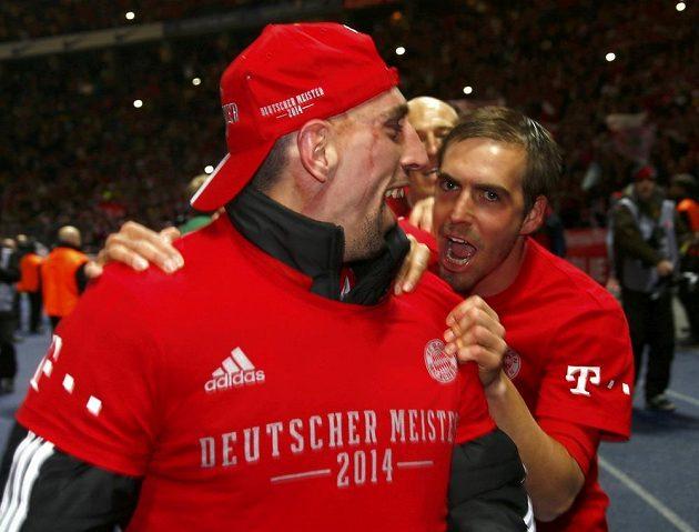 Radost fotbalistů Bayernu Francka Ribéryho a Philippa Lahma (vpravo).
