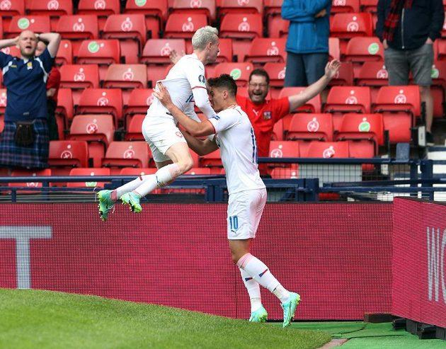 Unadulterated Czech joy.  Striker Patrik Schick celebrates a goal that scored Scotland for the EURO.  Jakub Jankto jumps into his arms.