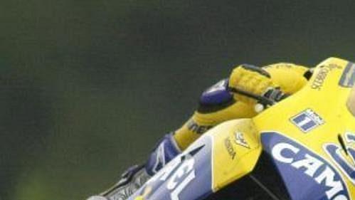 Ital Max Biaggi na stroji Honda při první tréninkové jízdě třídy MotoGP.