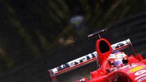 Rubens Barrichello smonopostem ferrari na trati GP vMonze.