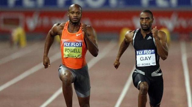 Tyson Gay (vpravo) při souboji s Asafa Powellem v Římě