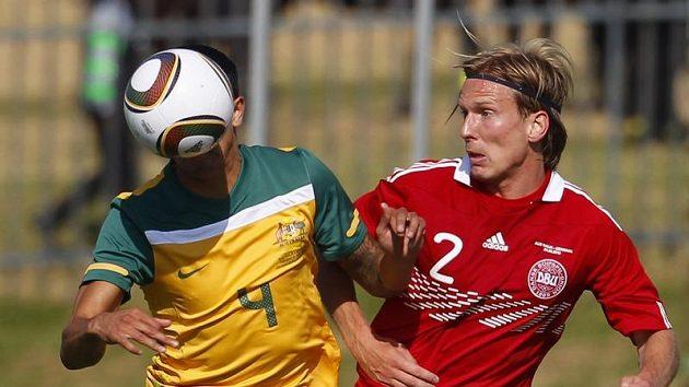 Christian Poulsen v dresu dánské reprezentace (vpravo).