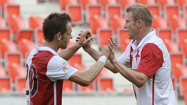 Střelci gólů Slavie Lukáš Jarolím (vlevo) a Stanislav Vlček se radují z vítězství