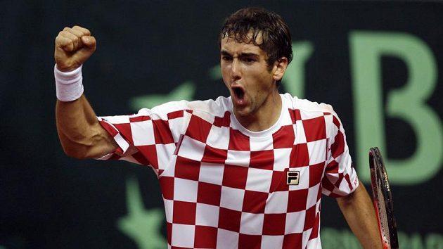 Chorvat Marin Čilič oslavuje vítězství