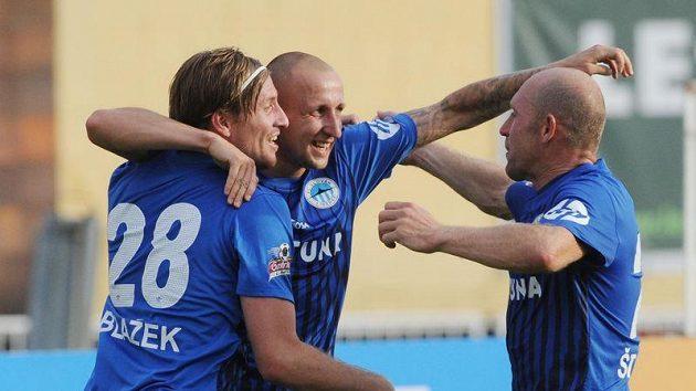 Liberečtí fotbalisté Jan Blažek, Michal Breznaník a Jiří Štajner (zleva) se radují z Breznaníkova gólu.