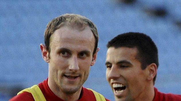 Roman Hubník (vlevo) a Milan Baroš - nejhorší a nejlepší hráč zápasu