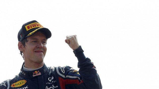 Sabastian Vettel se raduje z triumfu ve velké ceně Itálie.