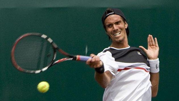 Argentinec Juan Ignacio Chela přehrál ve finále turnaj v Houstonu Američana Sama Querreyho po setech 5:7, 6:4, 6:3.