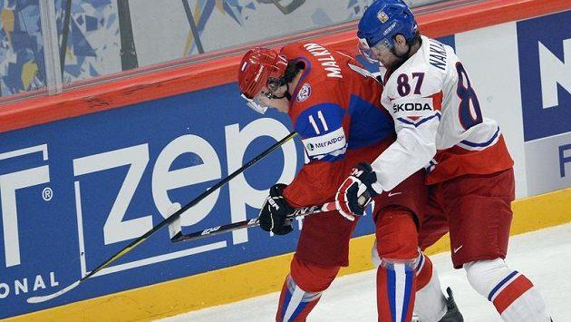 Jakub Nakládal brání ruskou hvězdu Jevgenije Malkina.