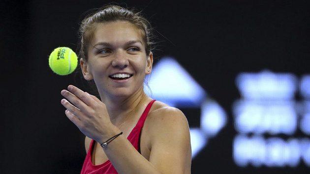 Plná úsměvů byla v zápase proti Marii Šarapovové Rumunka Simona Halepová.