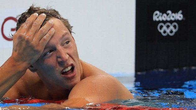 Plavec Jan Micka reaguje na čas, který dosáhl v rozplavbách na 1500 m volným způsobem.