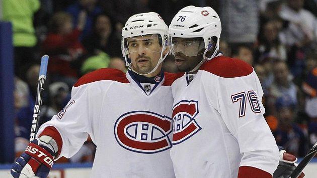 Útočníci Montrealu P.K. Subban (76) a Tomáš Plekanec slaví gól.