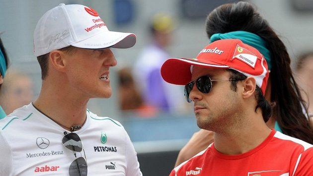 Brazilec Felippe Massa (vpravo) promluvil do médií o svém bývalém parťákovi z F1 - Michaelu Schumacherovi. (archivní snímek)