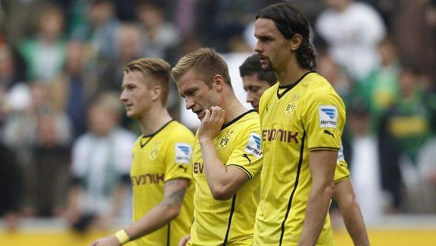 Zklamaní fotbalisté Dortmundu (zleva) Marco Reus, Jakub Blaszczykowski and Neven Subotic.