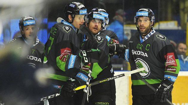 Hokejisté Mladé Boleslavi (zleva) David Bernad, David Němeček, Lukáš Pabiška a Michal Vondrka se radují z gólu v Plzni.