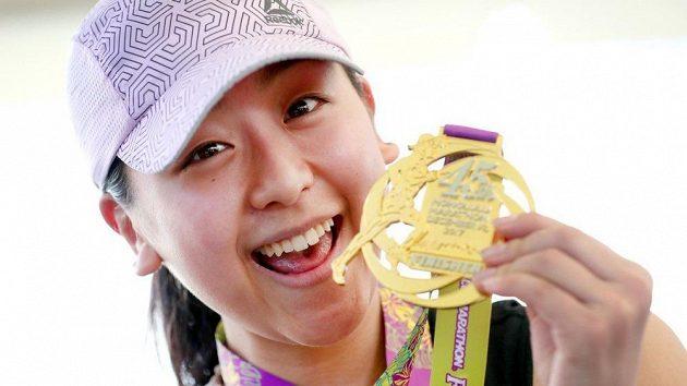 Maraton v Honolulu je krásný. Má jedinou chybu, že ne všichni si cílovou medaili opravdu zaslouží. (ilustrační foto)