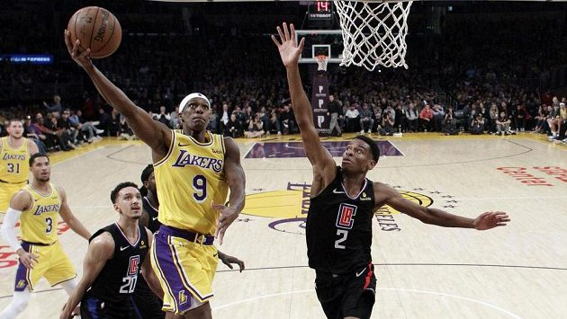 Los Angeles Lakers' Rajon Rondo (9) drives to the basket as Los Angeles Clippers' Shai Gilgeous-Alexander (2) defends during the second half of an NBA basketball game Monday, March 4, 2019, in Los Angeles. (AP Photo/Marcio Jose Sanchez)